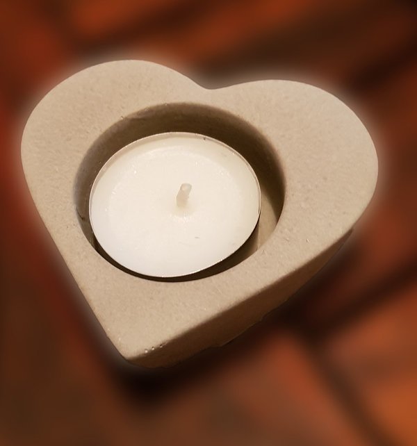 Heart-shaped tealight holder made of concrete